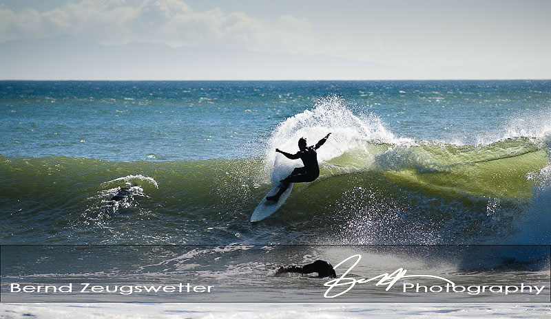 surfer dodging others in the water