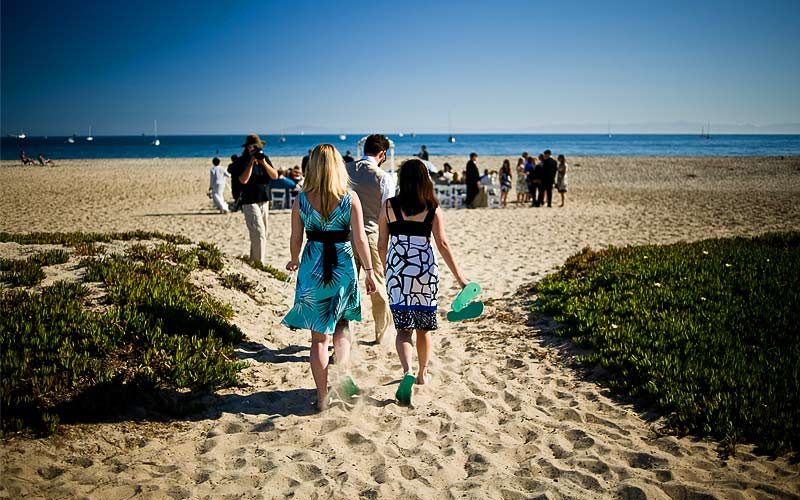 Two Wedding Guests walking in sand, Santa Barbara East Beach
