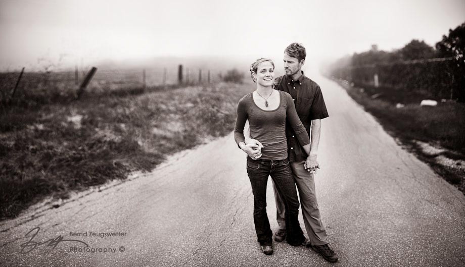 Portrait of couple standing on country road, Santa Barbara