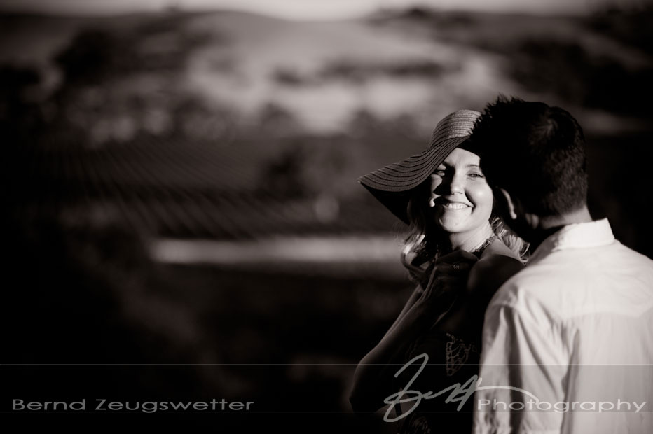 Fun Portrait of engaged couple overlooking vineyards, Santa Ynez.