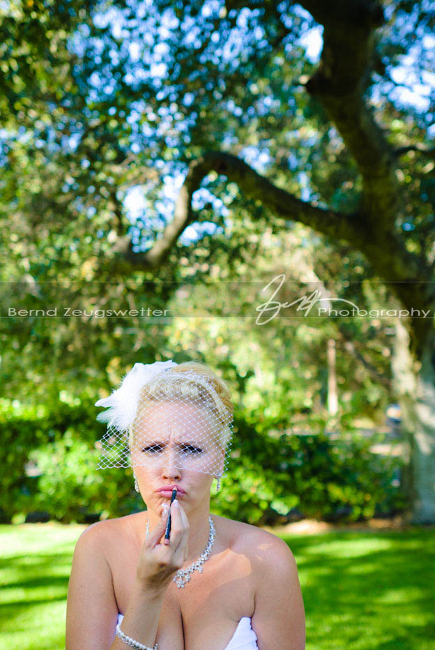 Photo of bride re-touching her lipstick, Sycamore Springs Resort and Spa