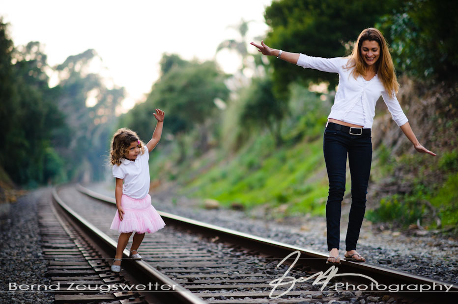 Mother and daughter balancing on tracks, Santa Barbara family portrait photography.