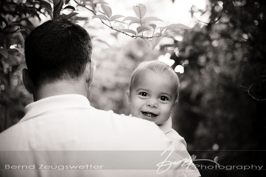Baby boy smiling over father