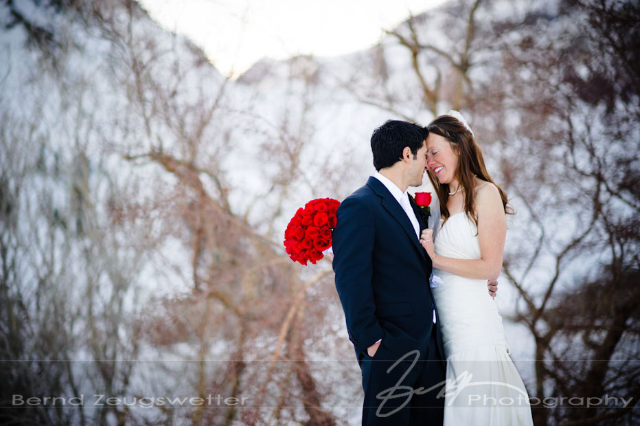 Wedding couple in the snow at Convict Lake Resort, Eastern Sierra, California.