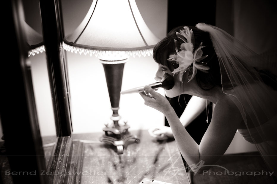 Bride doing her make-up before the wedding ceremony, Zaca Lake Resort.