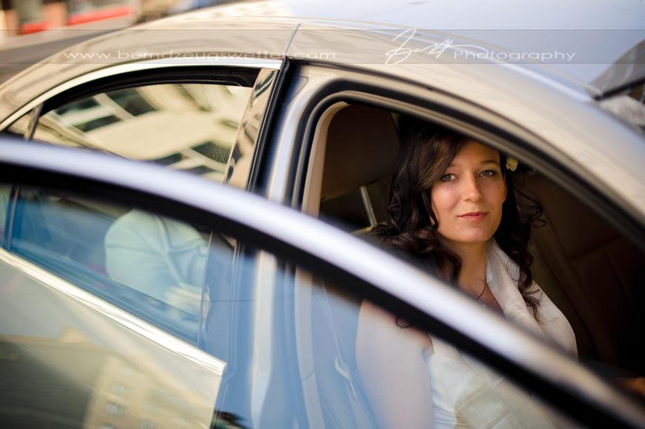 Bride in car on the way to ceremony, Vienna, Austria.