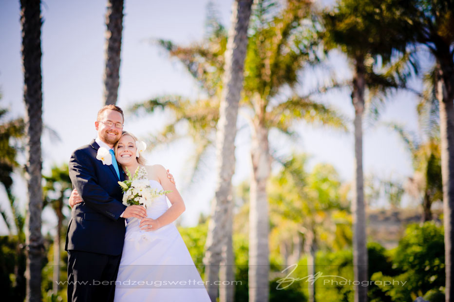 Portrait of newlywed couple at Rincon Beach, Santa Barbara wedding photography.