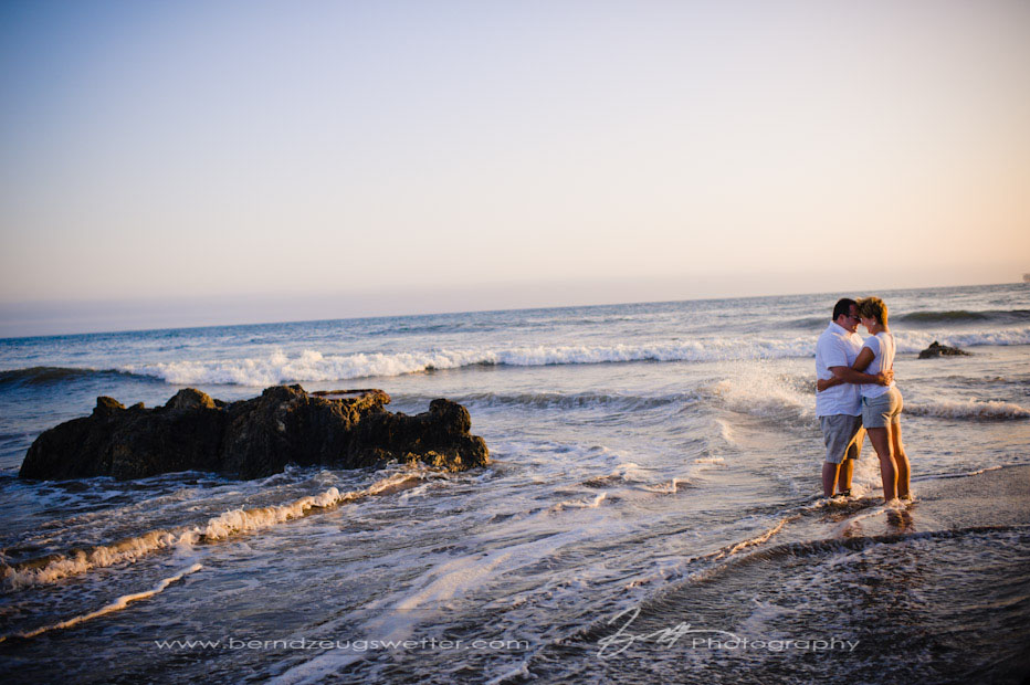 Couple in the surf at Coal Oil Point, Santa Barbara portrait photographer