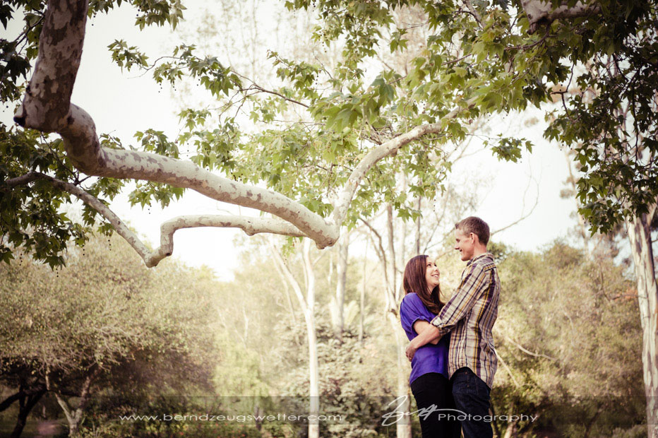Engagement photo of couple at Santa Barbara Mission under sycamore.