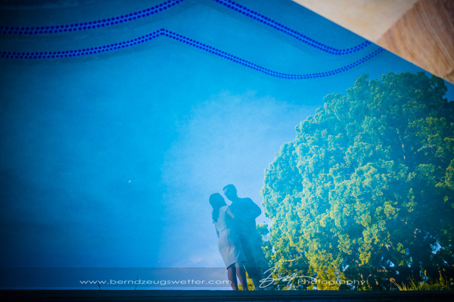 Reflection of couple and tree in swimming pool, Riviera, Santa Barbara.