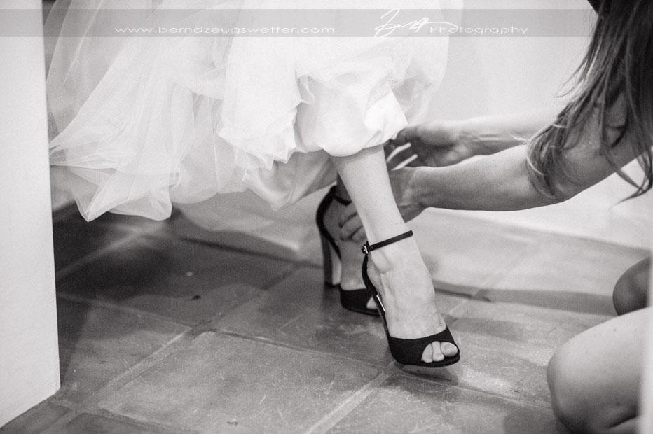 Bride putting on her shoes, Santa Barbara wedding photography.