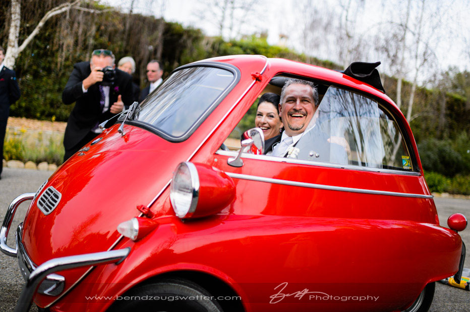Montecito wedding, Bride and Groom in red BMW Isetta 300.