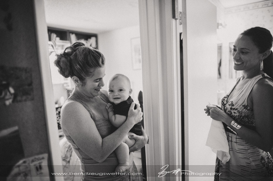 Bride holding her baby.