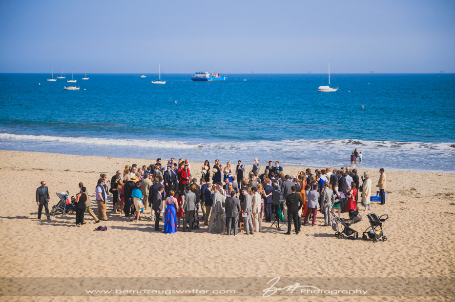 Wedding guests gathered on East Beach, Santa Barbara.