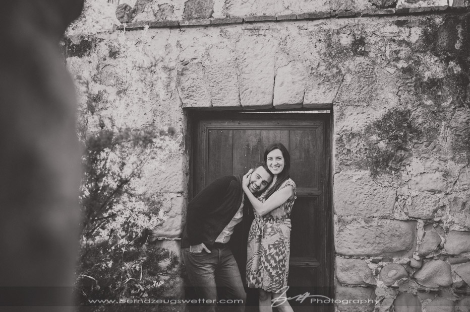cheerful couple portraits at the Mission in Santa Barbara.