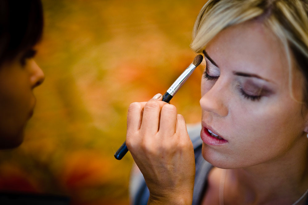 Bridesmaid getting ready with make-up at the Four Seasons Biltmore.
