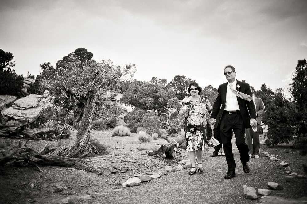 Wedding guests walking to the cliff-side ceremony.