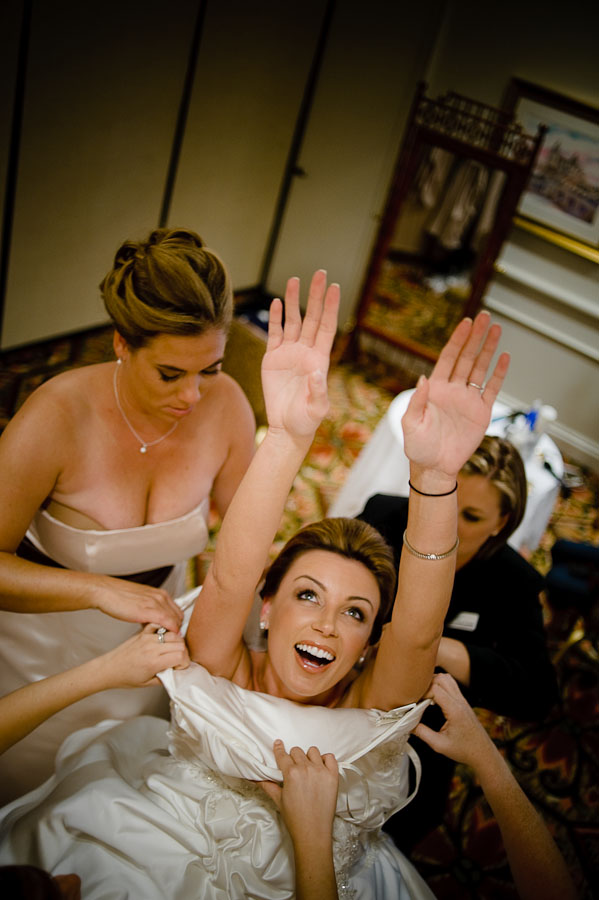 Bride being helped into her wedding gown, Santa Barbara.