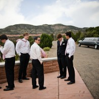 Groomsmen and groom waiting for everyone to arrive.
