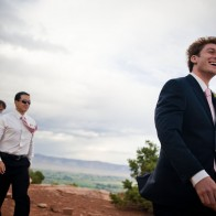 Groom and groomsmen walking to the site of the wedding ceremony.
