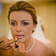 Finishing touches on the bride