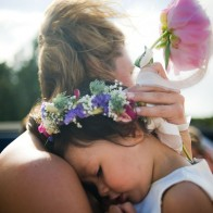 Flowergirl being held.