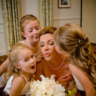 Bride getting kisses from the flower girls, Santa Barbara Biltmore.