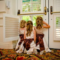 Flower girls peering out the window at the Four Seasons Biltmore.