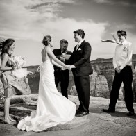 Crazy strong wind during the wedding ceremony at Wedding Canyon Overlook, Colorado National Monument.