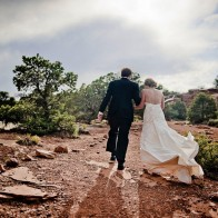 Bride and groom leaving the ceremony site, Colorado Plateau.