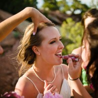 Bride reapplying lip gloss.