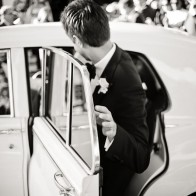 Groom getting into the white Rolls Royce, Santa Barbara.