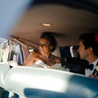 Bride and groom in their limousine, Santa Barbara.