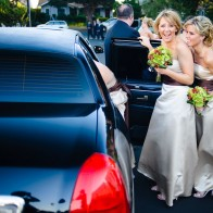 Bridesmaids getting into their limousine, Santa Barbara.
