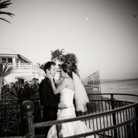 Bride and groom in embrace outside the Coral Casino, Santa Barbara Biltmore.