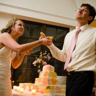 Bride and groom goofing-off with their first piece of cake.