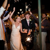 Bride and groom leaving the reception with sparklers.