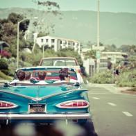 Groom driving vintage chevy impala in Santa Barbara.