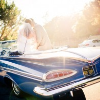 Bride and Groom kissing in vintage chevy impala, Montecito Country Club.
