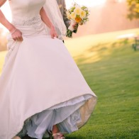 details of wedding dress and groom at the Montecito Country Club.