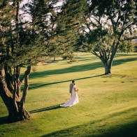 Bride and Groom walking at Montecito Country Club at sunset.