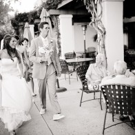 Bride and Groom walking by guests at restaurant, Montecito Wedding Photographer