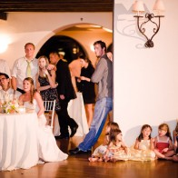 Bride and Groom and Wedding guests watching slide show at the Montecito Country Club.