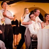Happy interaction between groom and Wedding guests.