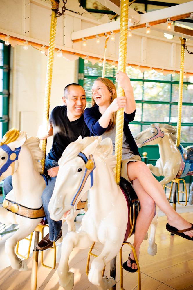 couple enjoying a ride on the carousel