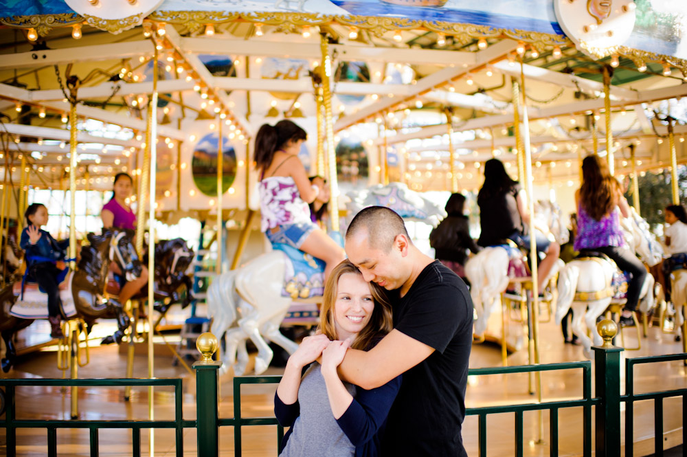 Couple portrait in front of the carousel in Santa Barbara.