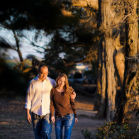 Engagement photos on the Douglas Family Preserve with couple walking in trees.