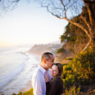 Couple on bluff overlooking the Santa Barbara coastline.