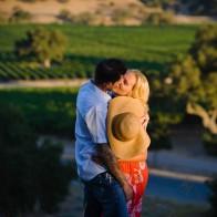 Portrait of couple kissing in evening light at Firestone Vineyard.