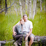 couple sitting in aspen trees.